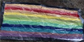painted rainbow flag with about 13 colors