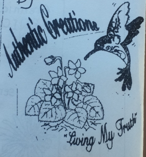 Authentic Creations. A Hummingbird approached a flower
