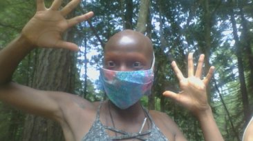 kuwa jasiri wears a mask with jazz hands